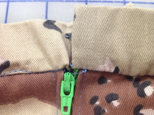 If I sewed the waistband on evenly, the teeth on the right wouldn't be visible.  Unpick and do again.