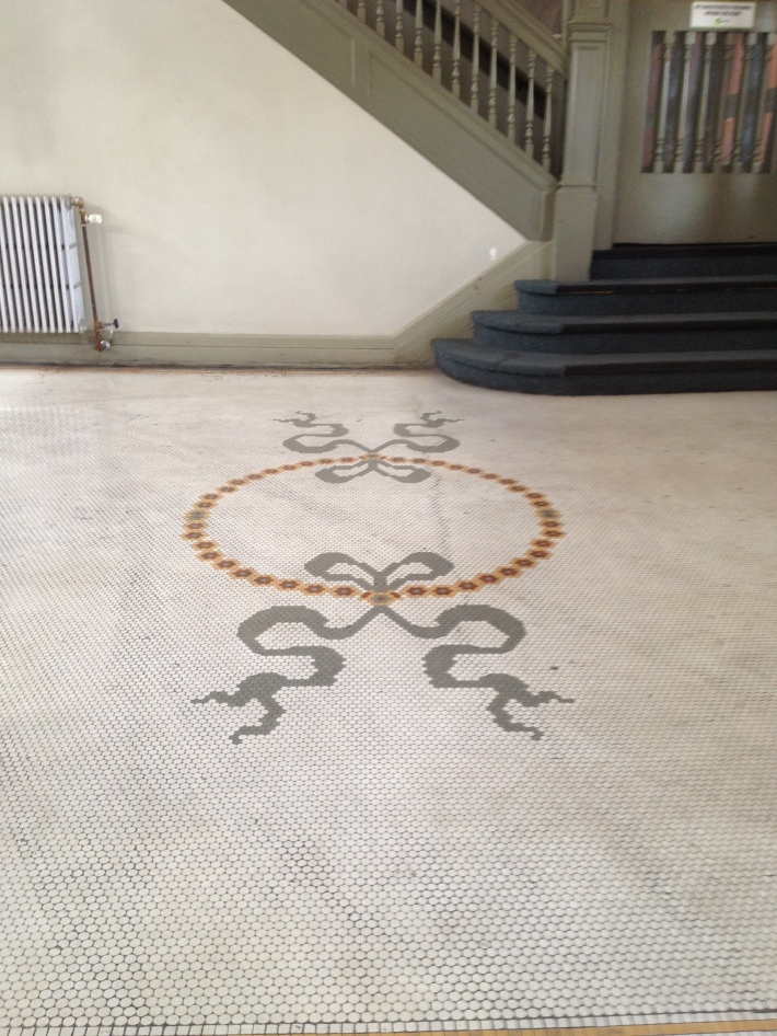 floor mosaic at the sides of the station hall